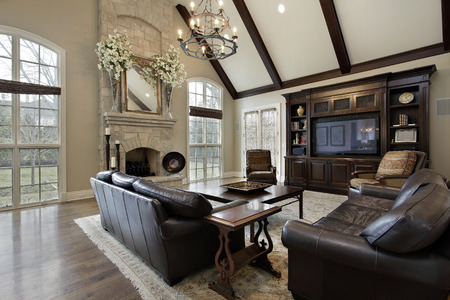home furnishing: Family room in luxury home with two story stone fireplace Stock Photo