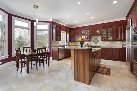 kitchen island: Kitchen with maroon walls and center island