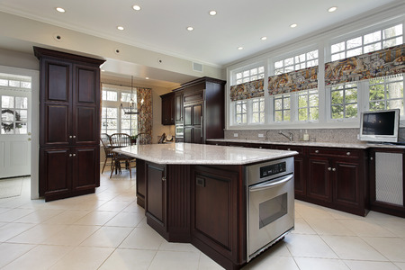 Kitchen in luxury home with cherrywood cabinetry Stock Photo