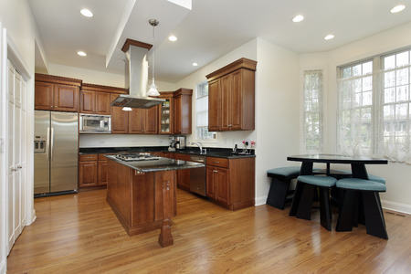 lighting fixtures: Kitchen in suburban home with oak wood cabinetry Stock Photo