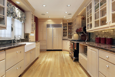 Kitchen in suburban home with oak wood cabinetry Stock Photo