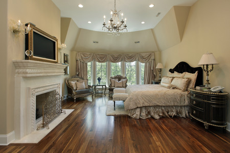 master bedroom: Master bedroom in luxury home with fireplace Stock Photo