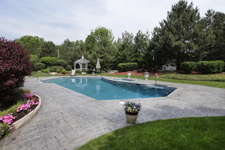 Swimming pool at luxury home with gazebo photo