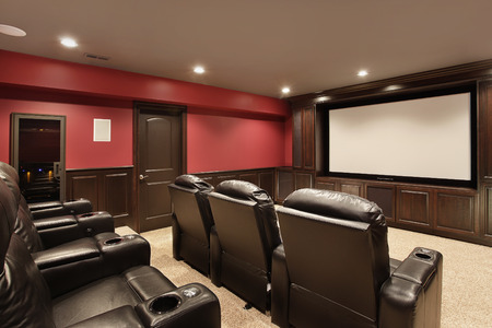 Theater in luxury home with red walls photo