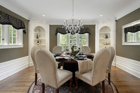 Dining room in luxury home white cabinetry photo