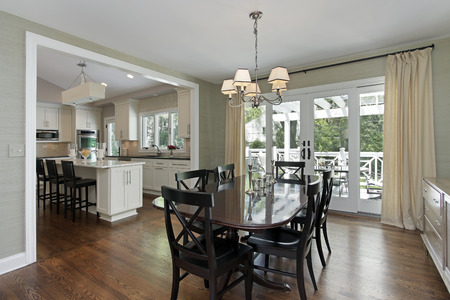 Dining room in luxury home with kitchen view photo