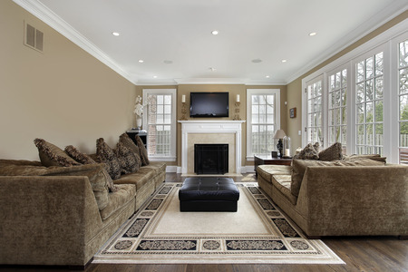 Family room in luxury home with wall of windows