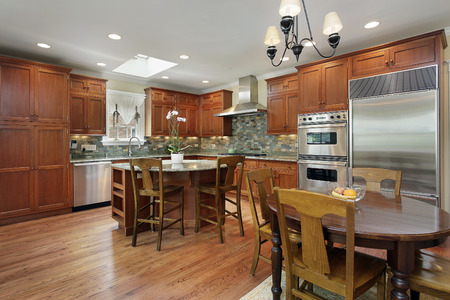 lighting fixtures: Kitchen with circular island and eating area