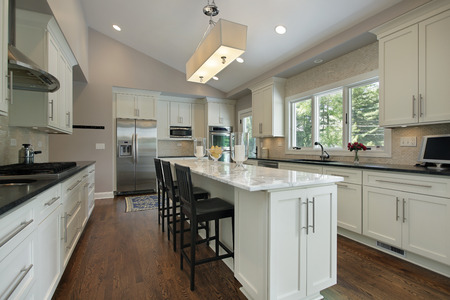 Kitchen in luxury home with granite counter island photo