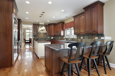 Kitchen with island and dark tile backsplash photo