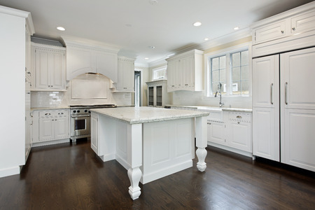 Kitchen in new construction home with white cabinetry photo