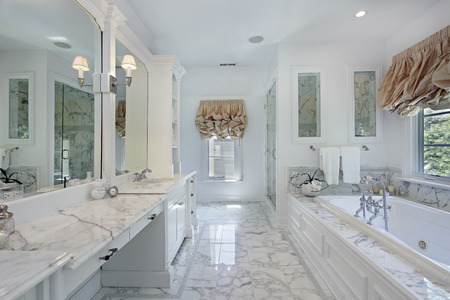 Master bath in luxury home with marble counters