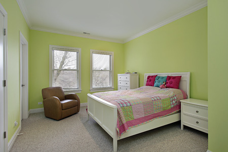 bedspread: Bedroom with lime green walls and plaid bedspread
