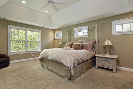 Master bedroom in luxury home with gold walls