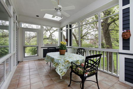 Porch in suburban home with tile floor 스톡 콘텐츠