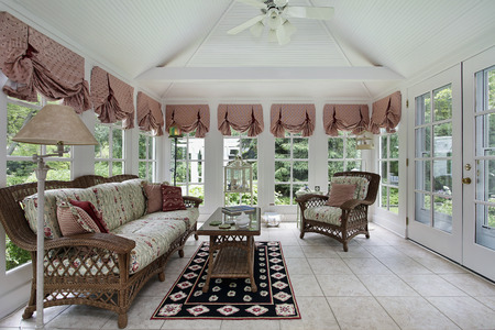 Sunroom in modern home with wicker furniture