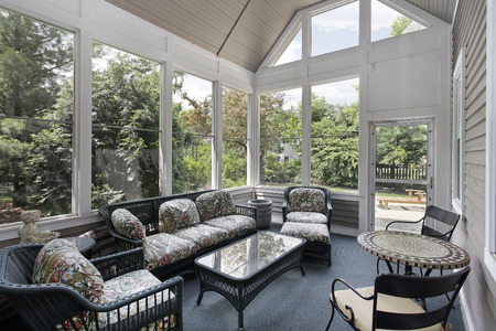 Porch in suburban home with wicker furniture Stockfoto