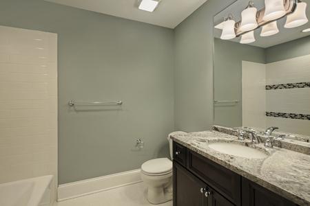 lighting fixtures: Bathroom in luxury home with granite counter top Stock Photo