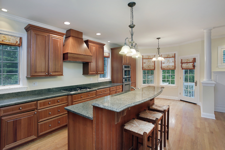 Kitchen in luxury home with granite top center island