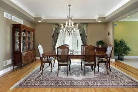 Dining room in suburban home with large carpet