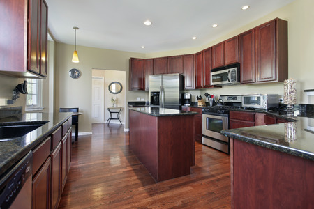 upscale: Kitchen in upscale home with cherry wood cabinetry