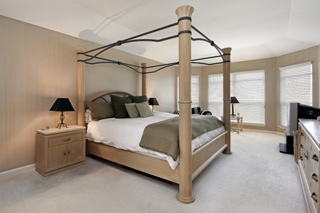 master bedroom: Master bedroom in suburban home with oak wood bed frame