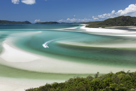 View from Hill Inlet of a wave runner in the waters of Whitsunday Island in Queensland, Australia