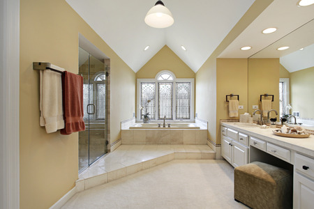 master: Master bath in suburban home with gold walls Stock Photo