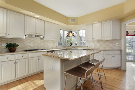 Kitchen in suburban home with white cabinetry Stock Photo