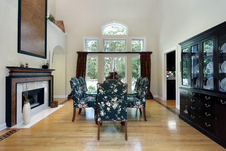 Dining room in luxury home with fireplace