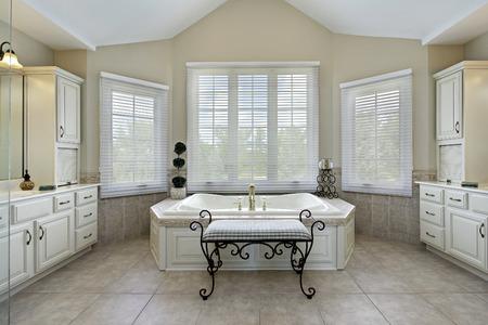 Master bath in luxury home with large bathtub