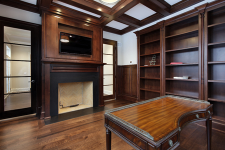furniture home: Library in new construction home with fireplace