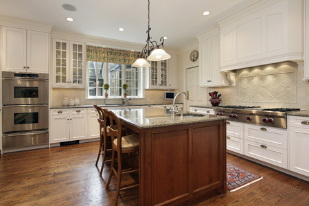 Kitchen with white cabinetry and center island Stock Photo