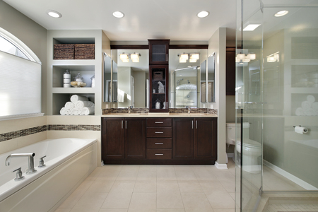 master bath: Master bath in luxury home with dark wood cabinetry