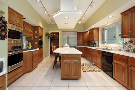 lighting fixtures: Kitchen with oak wood cabinetry and center island