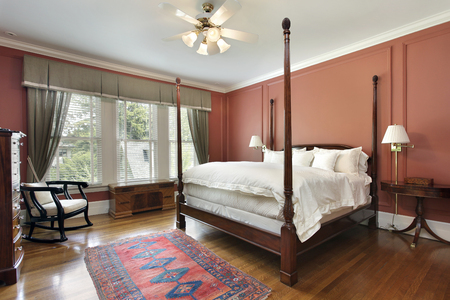 master bedroom: Master bedroom in luxury home with salmon colored walls