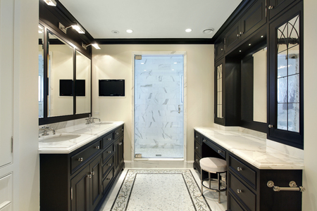 master: Master bath in luxury home with black cabinetry