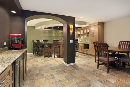 residential: Lower level basement with bar and chairs