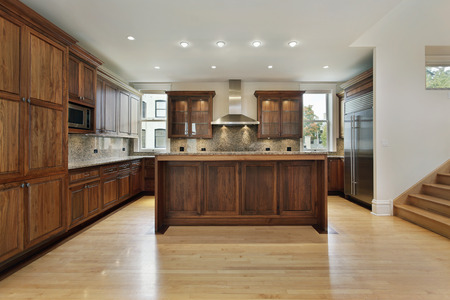 Kitchen in new construction home with wood cabinets Stock Photo