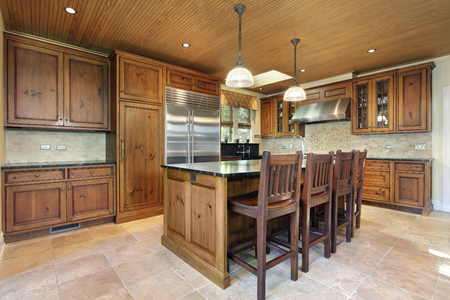 home  lighting: Kitchen in luxury home with wood cabinetry