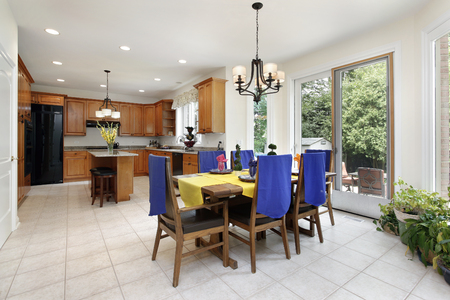 lighting fixtures: Kitchen with wood cabinetry and eating area