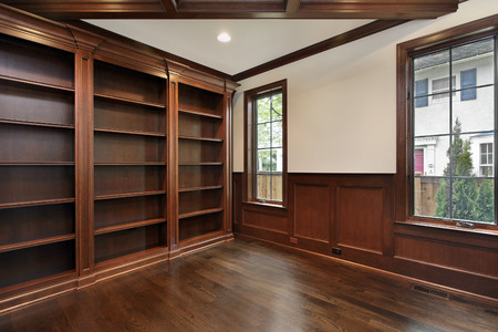 Library in new construction home with wood ceiling beam Archivio Fotografico