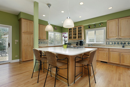 Kitchen in upscale home with oak wood cabinetry