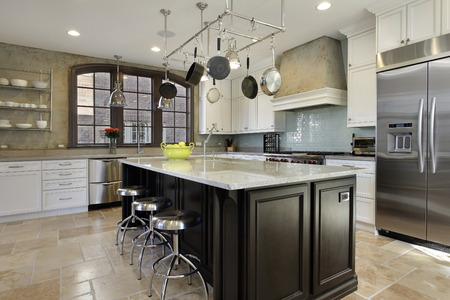 granite kitchen: Kitchen in luxury home with granite top center island