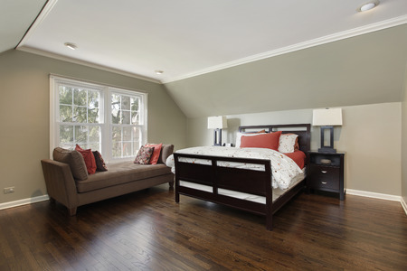 master bedroom: Master bedroom in suburban home with brown sofa