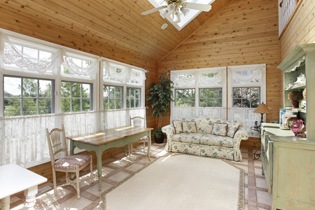 skylight: Sunroom in luxury home with skylight