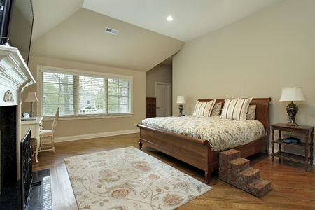 master bedroom: Master bedroom in upscale home with tan walls.