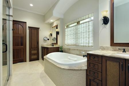 Master bathroom in luxury home with bathtub Stock Photo
