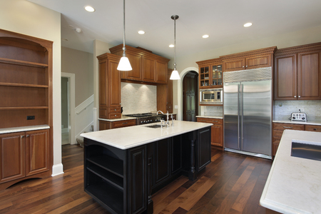 upscale: Kitchen in luxury home with dark wood island.