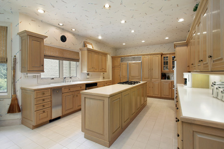 kitchen cabinets: Kitchen in upscale home with oak wood cabinetry. Editorial